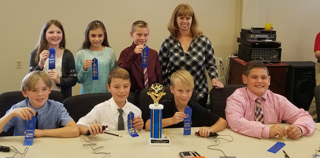 Edison Middle School's 5th-grade Academic Challenge Team earned 1st place at the Erie County Competition on Wednesday, October 23rd. They have advanced to compete again on December 3rd in the Quad-County competition which will be held at the Firelands BGSU campus. Students who will be competing are (Front Row left to right) Noah Schoenherr,  Trevor Leimeister, Luke Rodecker, Eli Hermes, (Back Row left to right) Ella Pennel, Aili Corfman, Trey Hines, and Mrs. Wilson.